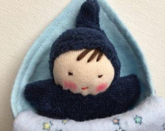 small navy blue Waldorf doll with blanket