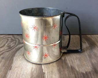 Androck Flour Sifter with Red Starbursts