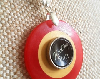 Genuine bakelite vintage red and cream two tone poker chip necklace   floating shift typewriter key   silver tone chain   lucky necklace