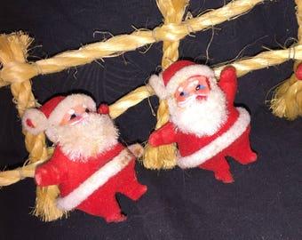 Vintage Santas on Twine Fence