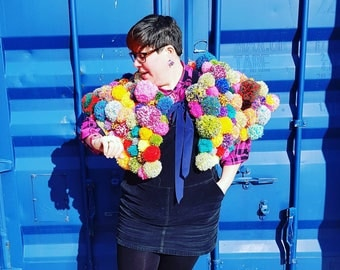 Lady Gwendolyn pom pom cape. Over 200 multicoloured rainbow hand made pom poms. A unique & magnificent statement accessory.