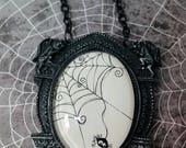 Spider in spiderweb set in gargoyle cameo pendant
