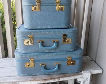 Two Blue Suitcase and Overnight Train Case with Key