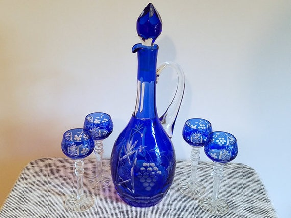 Gorgeous vintage cobalt blue glass cut to clear crystal Bohemian Czechoslovakian pitcher ewer and 4 long stemmed glasses