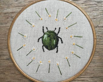Beetle hoop embroidery with daisy flowers