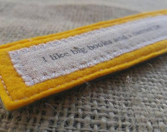 I like big books and I cannot lie. Canary yellow wool felt and printed cotton bookmark