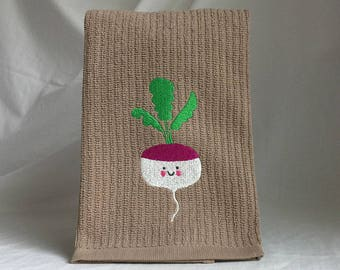 Embroidered happy turnip on brown vertical bar towel