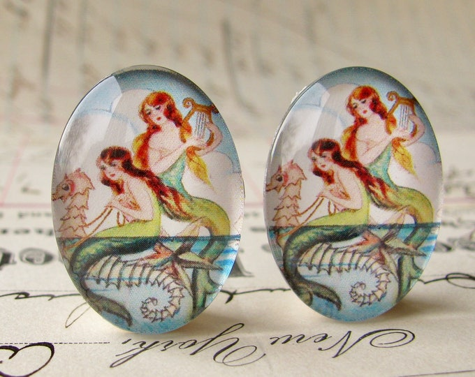 Pair of mermaids riding on a seahorse, two handmade glass oval cabochons from our Magical Maidens collection, vintage image 25x18mm 18x25mm