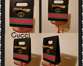 Black red and green favor bags