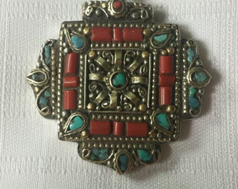 Ethnic pendant with turquoise and coral