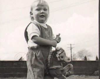 Cute Little Girl Rides a Stick Horse Vintage Photo