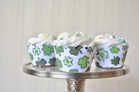 18 x St. Patrick's Day Shamrock Cupcake Wrappers - featuring a wonderful mixture of green shamrocks on a white background. Limited Qty Item.