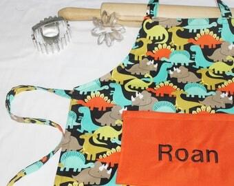 Personalized Dinosaurs on Black Child Apron with orange pocket