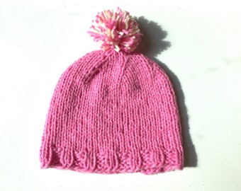 Cotton pom pom baby hat pink hand knitted