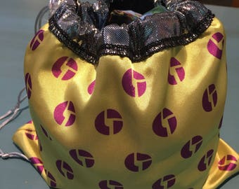 Disco Biscuit reversable satin pouch with drawstring and toggle  ; yellow and pink with silver shiny lining