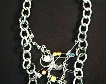 Safety Pin and Chain punk style necklace. silver safety pins, aluminum chain, pearls, and gemstone beads.