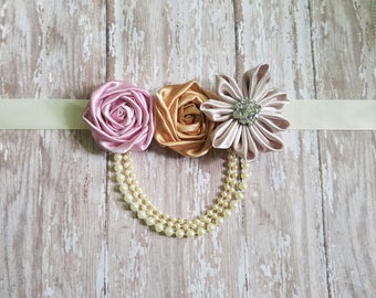 Gold pink and champagne cream rosette sash