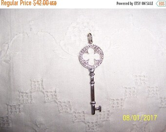 TWICE A YEAR, 25% Off Vintage Clear Cubic zirconias key pendant. Sterling silver.