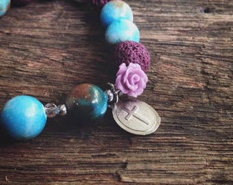 Blue and purple rosary elastic beaded bracelet pink quartz cross bead carved rose bead pretty rosary bracelet