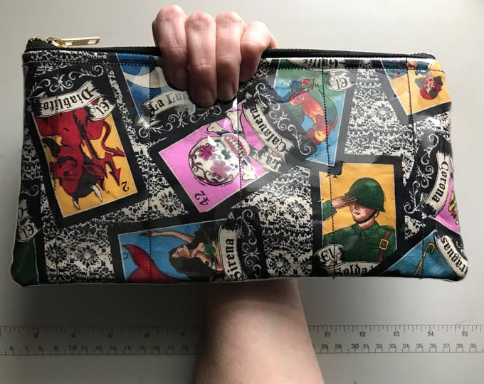 Lolita wristlet/clutch (Made of fabric with clear vinyl top layer)