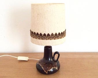 Small mid-century dark brown ceramic table lamp, night light or accent lamp with beige/brown decor. Ceramic lamp base. Pottery lamp.
