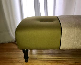 One of a kind upholstered ottoman in a rugged woodsy green wool