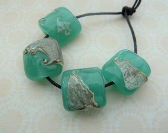 handmade lampwork glass beads, green and ivory shard set UK