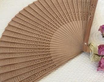 Vintage Wooden Fan. Wooden Fan With Light Yellow Cord and Tassel. Openwork Geometric Type Designs.