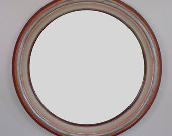 classic round wood mirror. 36 inches by 3.5 inches