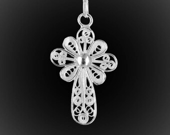 Delicate embroidery with silver cross pendant