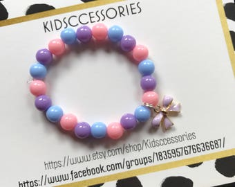 pink, blue, and purple bow bracelet