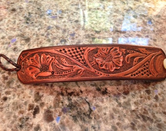 Floral tooled leather cuff in Hermann Oak leather
