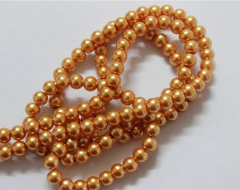 150 wire glass Pearl mother of Pearl round dia 6mm gold
