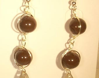 Earrings wire wrapped in copper wire and brown glass beads