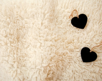 Digital backdrop, white sheepskin rug, black hearts which you can write baby details on.