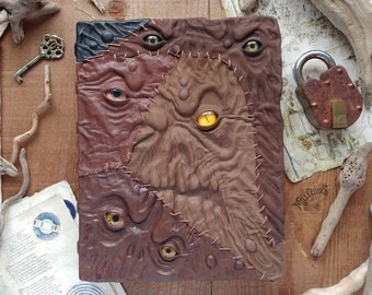 Grand creeper grimoire, handmade leather book of shadows, multiple eyes, glass eye, brown leather, dark goth bookbinding handcraft cover