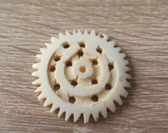 pretty flower pendant made of vegetable ivory