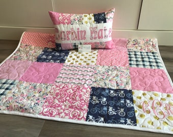 Art gallery flowers and bicycle, pink and blue baby quilt and pillow set.