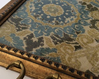 Upcycled gold and black vintage frame tray with vintage brass handles and vintage inspired green and blue floral upholstery fabric