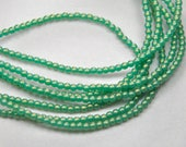 Czech pressed glass 2mm round druk beads sueded gold Atlantis green 100 beads