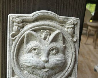 Carruth Studio's  smiling cat welcome plaque, welcome cat
