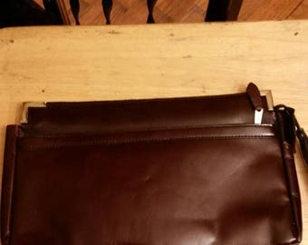Vintage maroon mahogany leather clutch purse with wristlet.