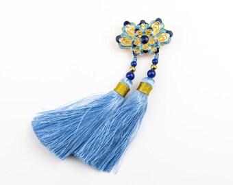 Oriental style enamel blue lotus flower brooch with light blue tassels