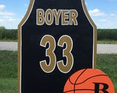 Basketball jersey and basketball yard sign on metal stake personalized with name, number and logo.