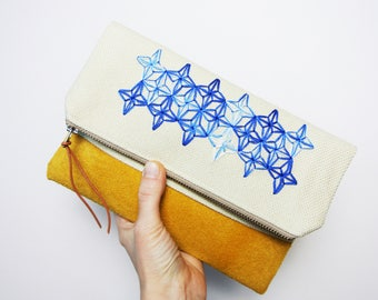 Fold over clutch with embroidery detail / Suede and Canvas
