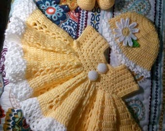 Pretty yellow crochet baby dress set, with booties and hat.