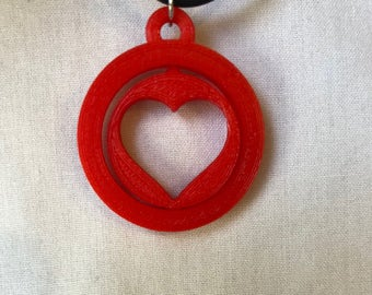 Twisting heart necklace