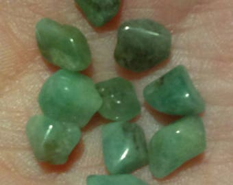 Lot of 10 small gemmy polished emeralds