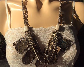 Chunky dangling charm necklace.  Repurposed beads and chain with new embossed metal blanks and filigrees.  Lovely.