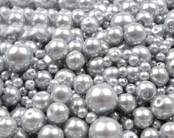18 B - 100 g of 4-12 mm glass pearl beads different sizes